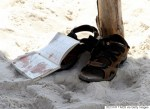 The bloodstained belongings of a tourist are seen on the sand in the resort town of Sousse, a popular tourist destination 140 kilometres (90 miles) south of the Tunisian capital, following a mass shooting on June 26, 2015. At least 37 people were killed and 36 wounded when a gunman opened fire on holidaymakers at a Tunisian beach resort hotel, the health ministry said. AFP PHOTO / BECHIR TAIEB        (Photo credit should read BECHIR TAIEB/AFP/Getty Images)